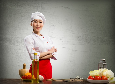 Asian cook woman crossed her arms and smiles Stock Photo - 17194088
