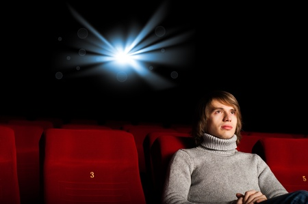 young man in casual sitting in the cinema and watching a movie Stock Photo - 17194086