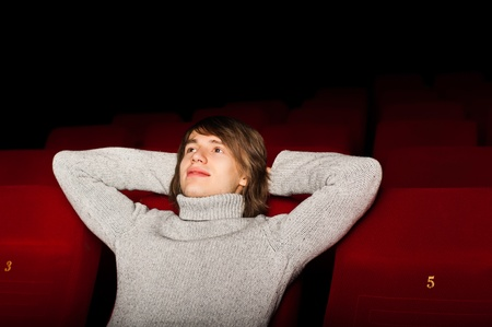 young man in casual sitting in the cinema and watching a movie Stock Photo - 17283390