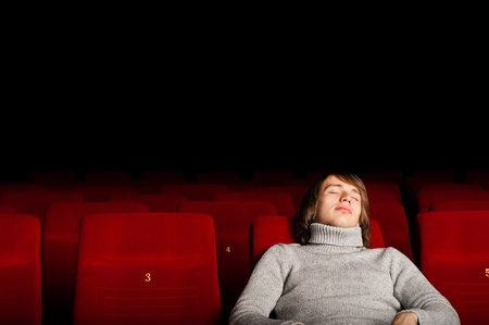 young man in casual sitting in the cinema and watching a movie Stock Photo - 17283379