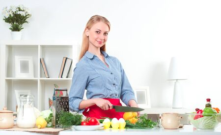 woman cooking: portrait beautiful woman cooking vegetables, healthy lifestyle