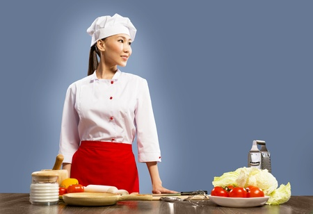 Asian female chef looking at the space for text Stock Photo - 17317257