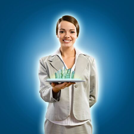 attractive young woman holding a tablet, it is a city, the concept of digital technology Stock Photo - 17317262