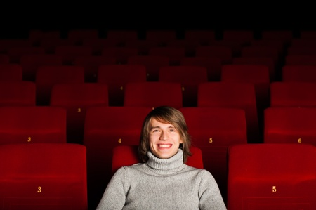 young man in casual sitting in the cinema and watching a movie Stock Photo - 17347353