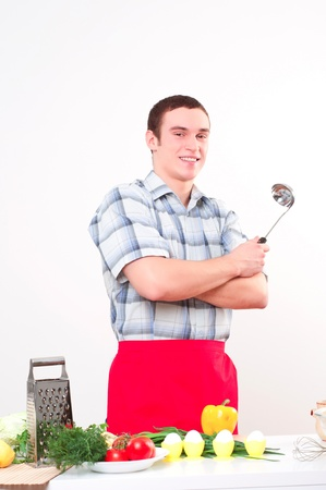 toque blanche: portrait of a young man, hold ladle and smile