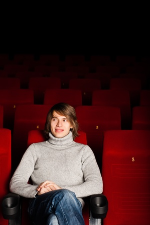 young man in casual sitting in the cinema and watching a movie Stock Photo - 17384972