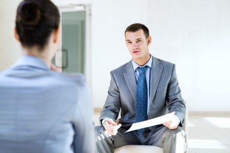 Businessman talking to a woman for a job, interviewing photo