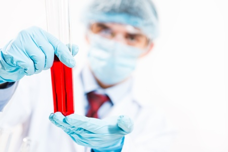 scientist working in the lab examines a test tube with liquid Stock Photo - 17450688