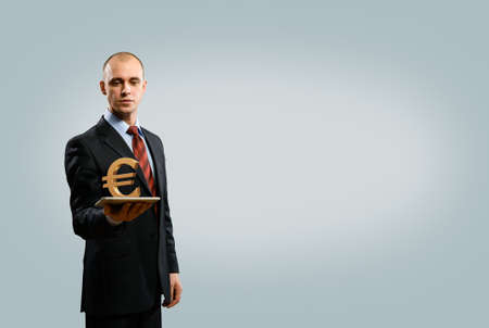 man holding tablet with euro symbol, money concept photo