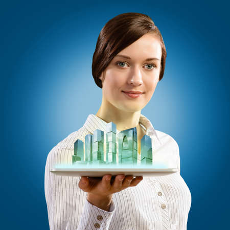attractive young woman holding a tablet, it is a city, the concept of digital technology Stock Photo - 17514562