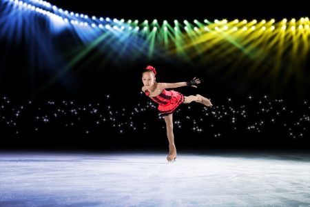 young skater performs on the ice in the background lights lighting Stock Photo - 17536959