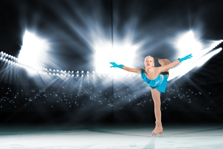 young skater performs on the ice in the background lights lighting Stock Photo - 17536957