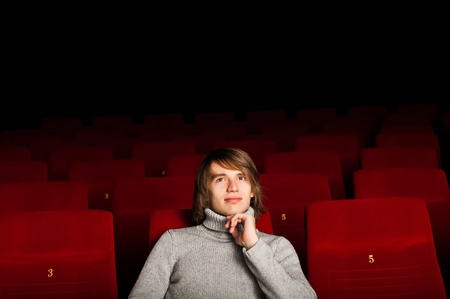 young man in casual sitting in the cinema and watching a movie Stock Photo - 17514549