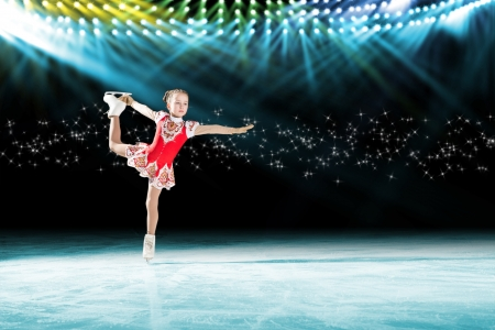 young skater performs on the ice in the background lights lighting Stock Photo - 17537107