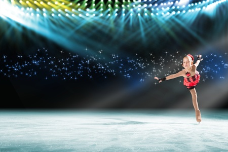 young skater performs on the ice in the background lights lighting Stock Photo - 17537116