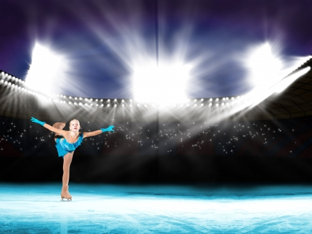 young skater performs on the ice in the background lights lighting Stock Photo - 17537114