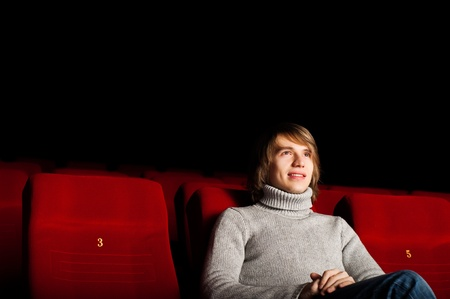 young man in casual sitting in the cinema and watching a movie Stock Photo - 17514552