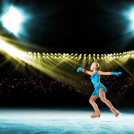 young skater performs on the ice in the background lights lighting Stock Photo - 17537100