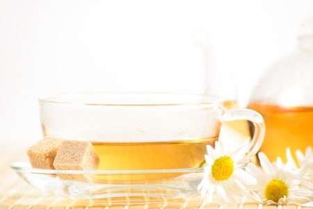 A teacup and a teapot with herbal chamomile tea Stock Photo - 17626841