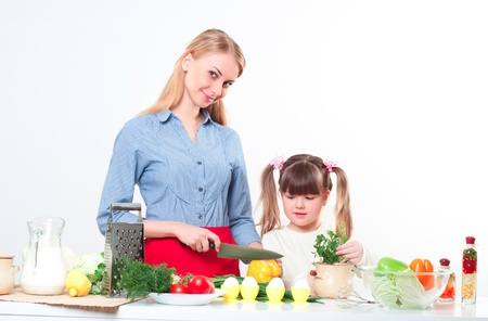 Mother and daughter cooking together, help children to parents Stock Photo - 17572949