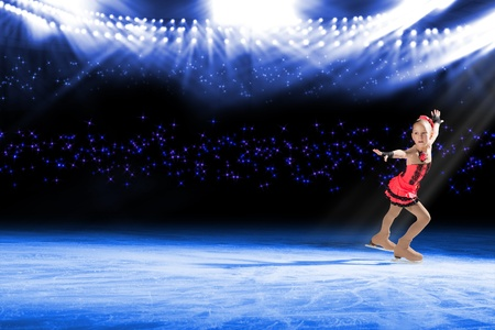 young skater performs on the ice in the background lights lighting Stock Photo - 17572942