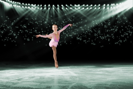 young skater performs on the ice in the background lights lighting Stock Photo - 17547250