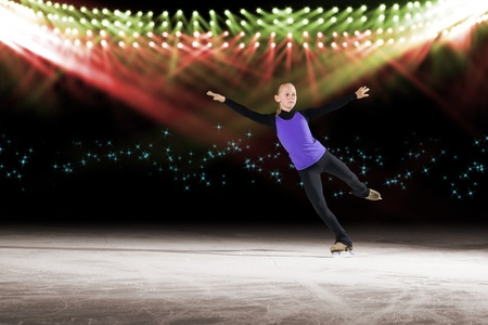 young skater performs on the ice in the background lights lighting Stock Photo - 17547246