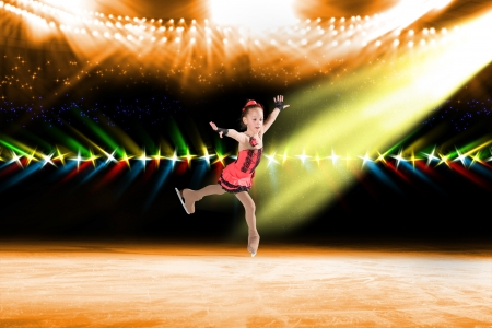 young skater performs on the ice in the background lights lighting Stock Photo - 17547255