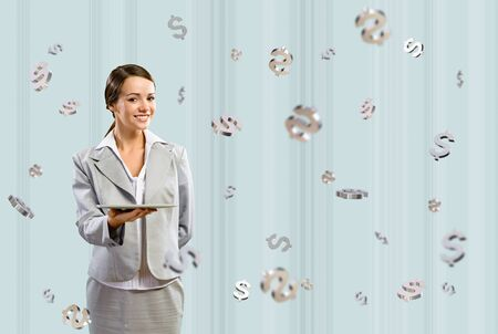 attractive business woman smiling and holding a tablet, around 3d flying dollars, concept of business success Stock Photo - 17547253