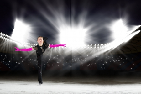 young skater performs on the ice in the background lights lighting Stock Photo - 17547244