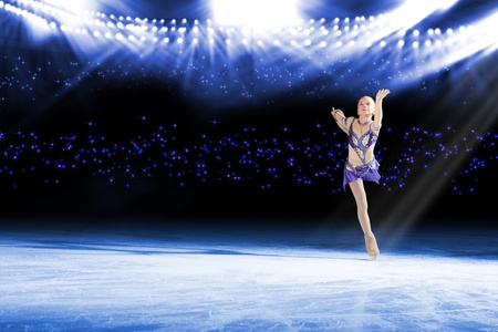 young skater performs on the ice in the background lights lighting Stock Photo - 17547251