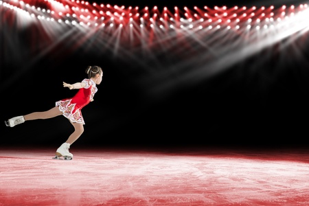 young skater performs on the ice in the background lights lighting Stock Photo - 17547247