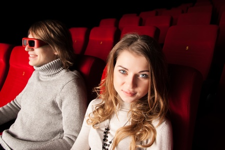 young couple in the cinema to enjoy the movie Stock Photo - 17572958