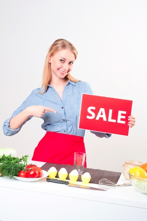 woman holding a plate with an inscription Sale Stock Photo - 17572955