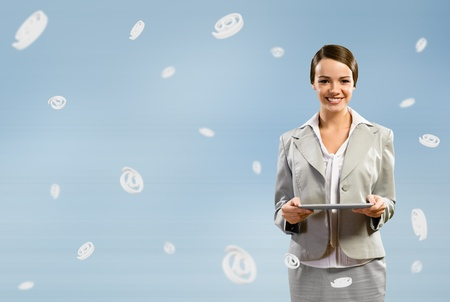 attractive business woman holding a tablet, fly around the signs e-mail Stock Photo - 17573609