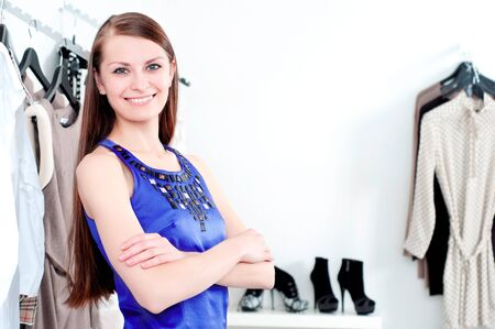 bankcard: young Beautiful woman in mall buying clothes