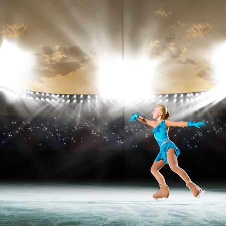 young skater performs on the ice in the background lights lighting Stock Photo - 17573637