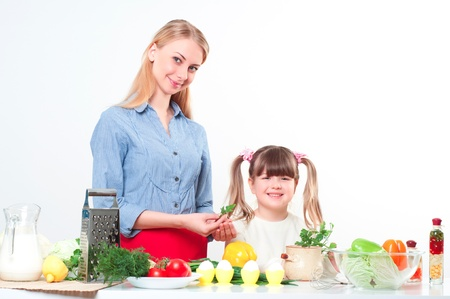 Mother and daughter cooking together, help children to parents Stock Photo - 17573640