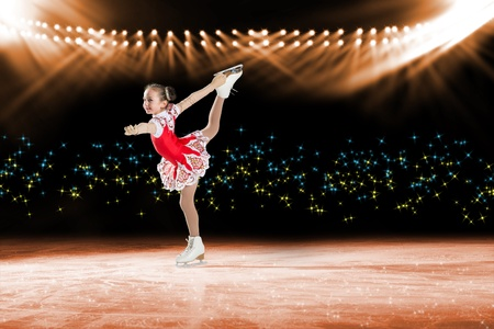 young skater performs on the ice in the background lights lighting Stock Photo - 17573635