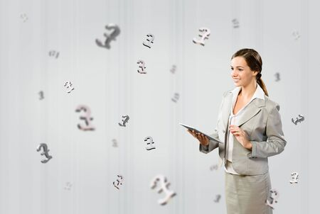 attractive business woman holding a tablet and smile, financial concept Stock Photo - 17567248