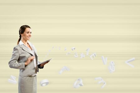 Attractive business woman is working with the tablet, Concept of digital technology Stock Photo - 17567260