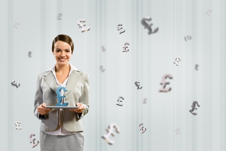 attractive business woman holding a tablet with british pound, financial concept Stock Photo - 17567249