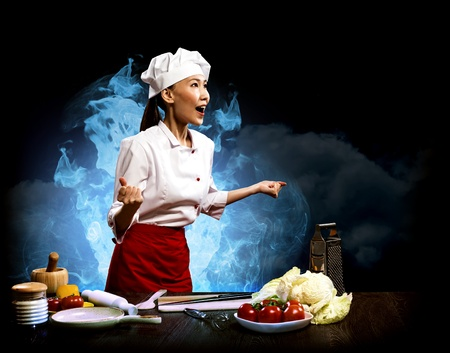 Asian woman furious chef shouting with clenched fists, smoke and blue flames of rage Stock Photo - 17567255