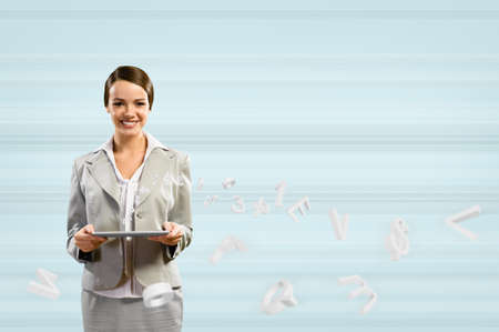 attractive business woman holding a tablet, Concept of digital technology Stock Photo - 17567251