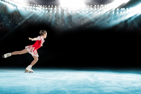 young skater performs on the ice in the background lights lighting Stock Photo - 17567245