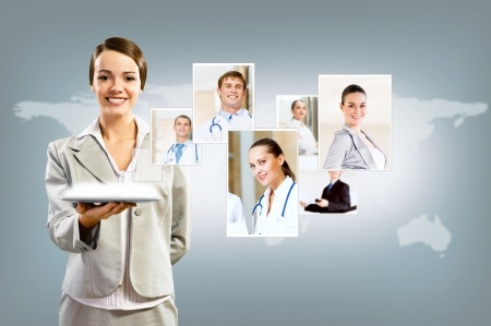 attractive woman holding a tablet pc and smiling, concept of social networks, collage Stock Photo - 17567259