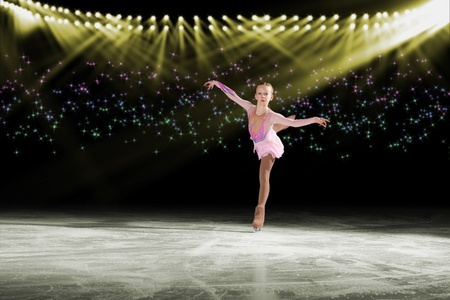 young skater performs on the ice in the background lights lighting Stock Photo - 17567250