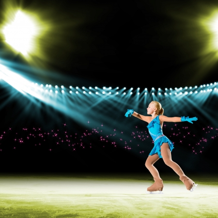 young skater performs on the ice in the background lights lighting Stock Photo - 17639635