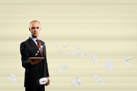 businessman holding a tablet, around 3d simbols, digital concept photo