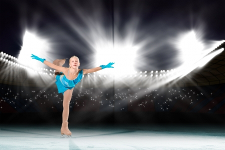 young skater performs on the ice in the background lights lighting Stock Photo - 17824234